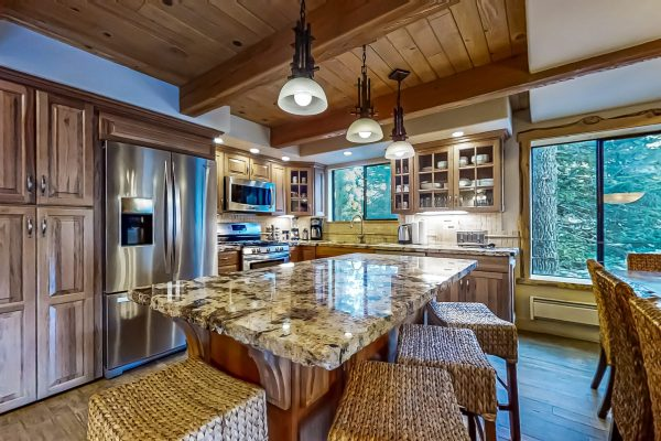 Fully Stocked Gourmet kitchen, gas cooking, pantry and granite service island
